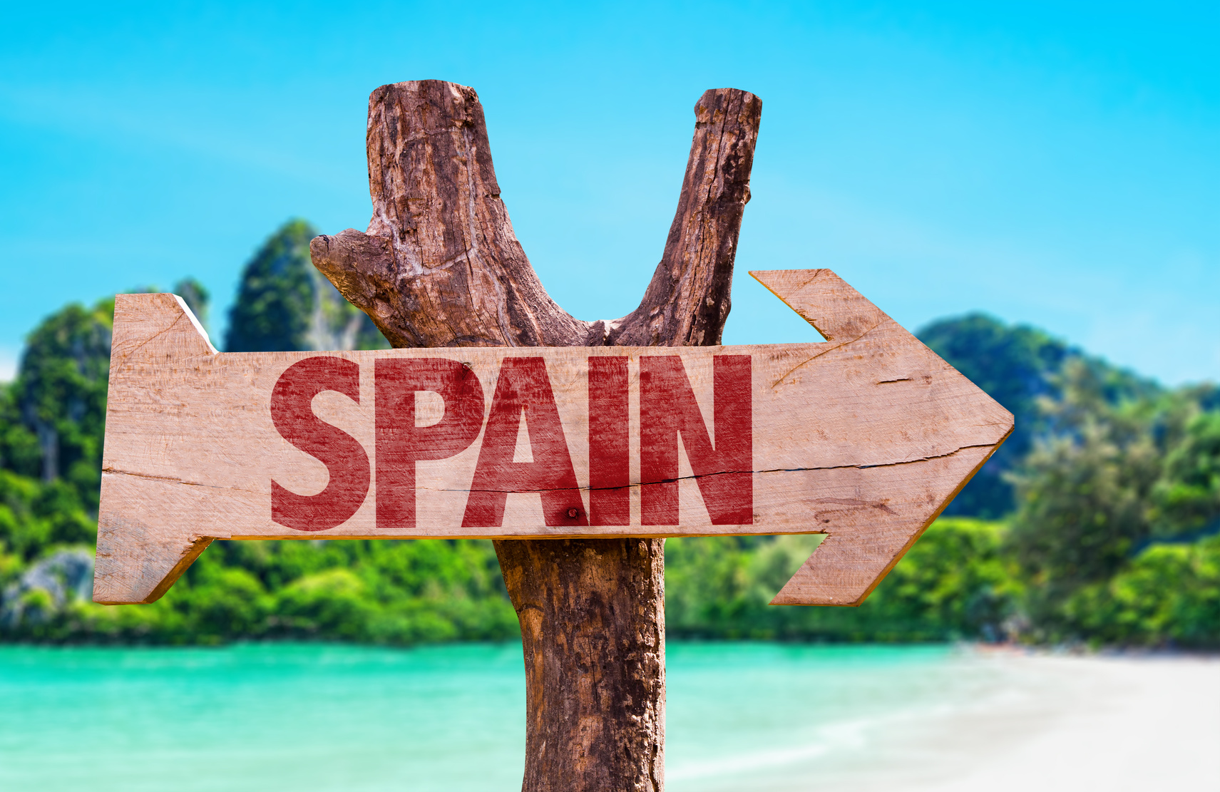 Spain wooden sign with beach background